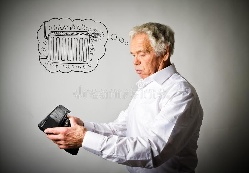Old man in white and empty wallet. Old man in white and heating season. Radiator. Worried old man in white is looking at an empty wallet. Old man in white and stock image