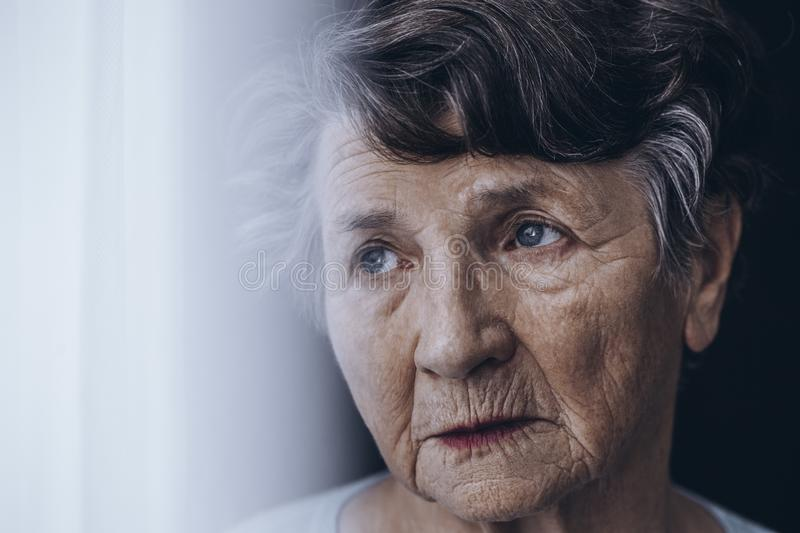 Worried old woman`s face royalty free stock photography