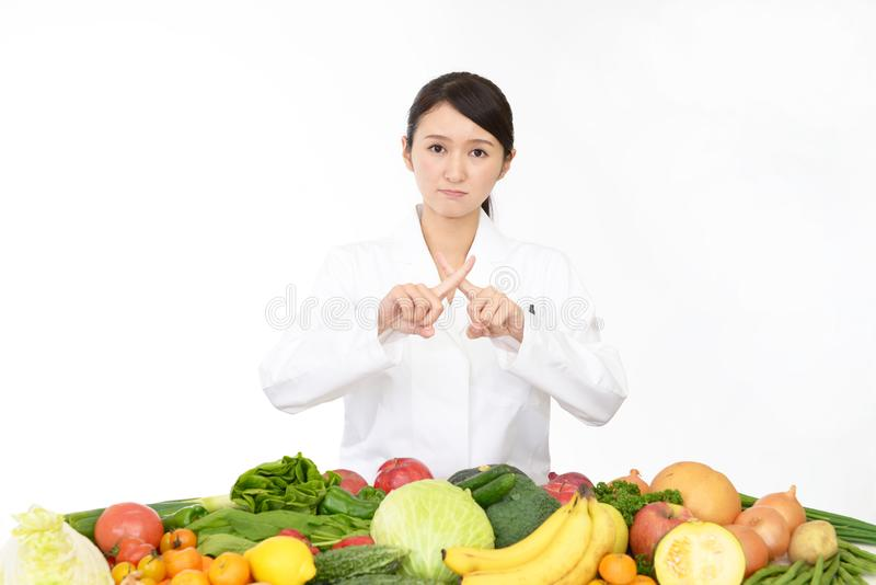Worried registered dietitian. A registered dietitian demonstrating prohibiting gesture stock image
