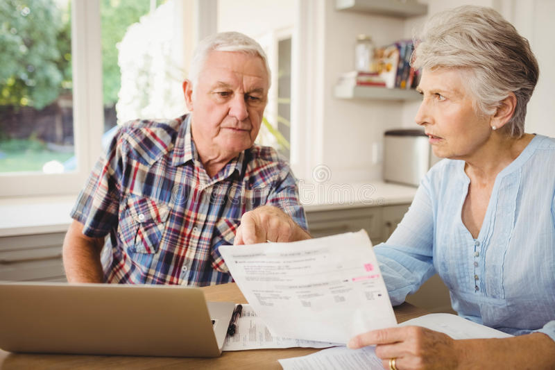 Worried senior couple discussing their bills royalty free stock photo