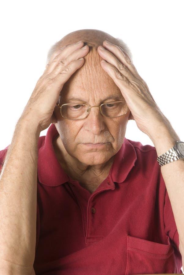 Worried senior man. On white background royalty free stock photos