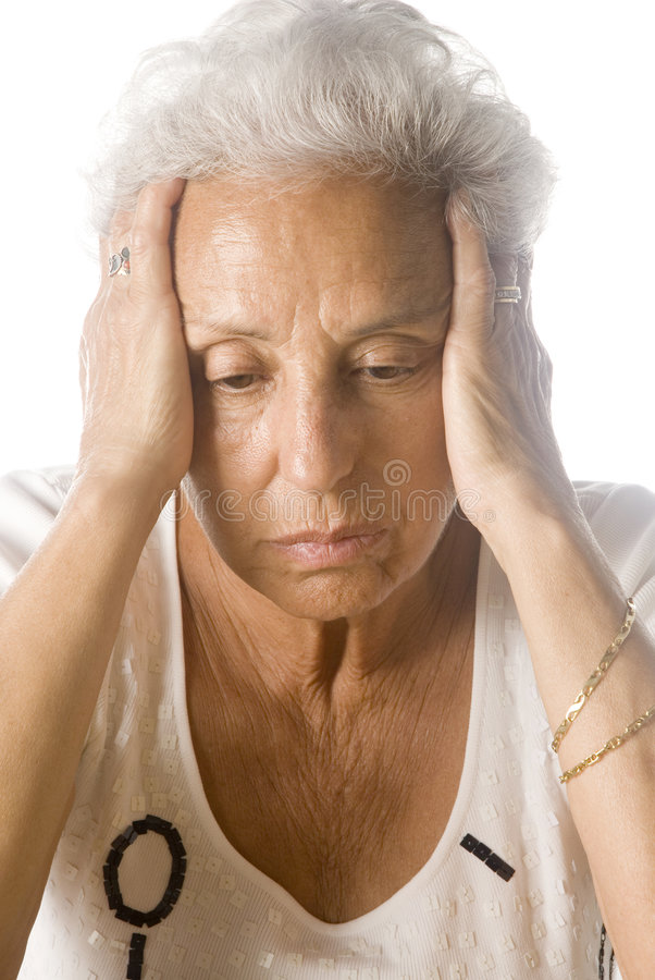 Worried senior woman. On white background stock images