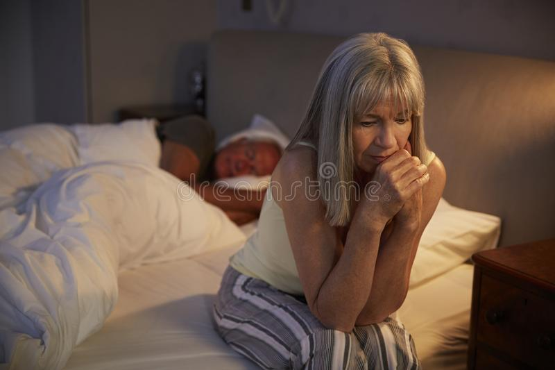 Worried Senior Woman In Bed At Night Suffering With Insomnia stock photos