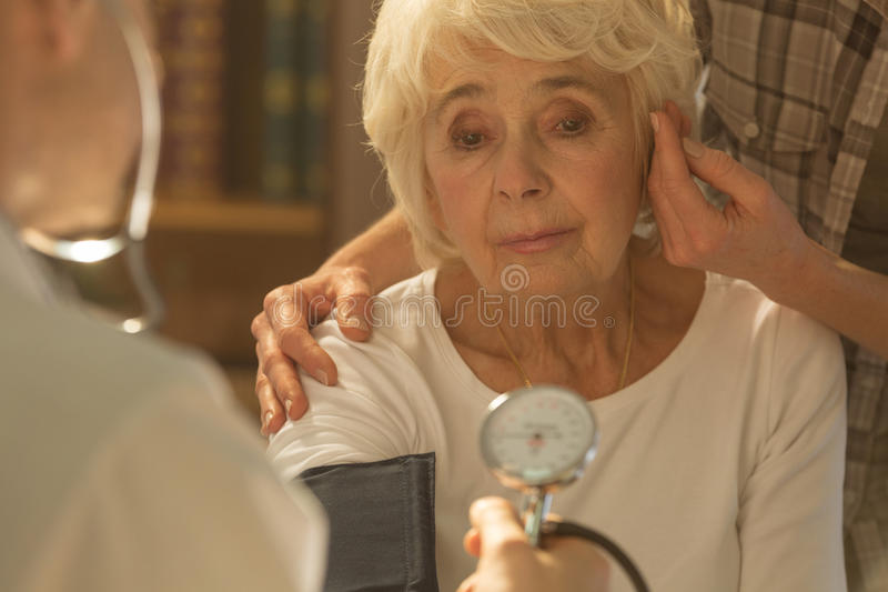 Worried senior woman and doctor royalty free stock images