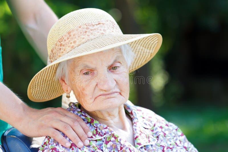 Worried senior woman stock image