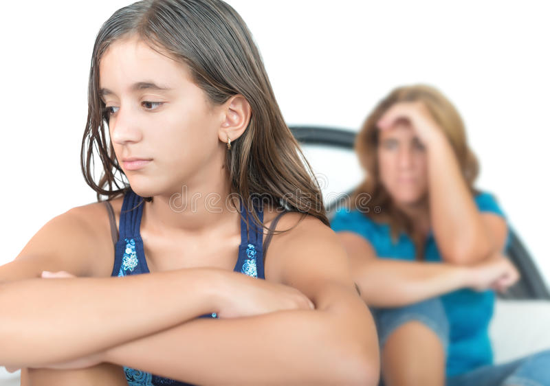 Worried and thoughtful teenage girl with her mother stock images