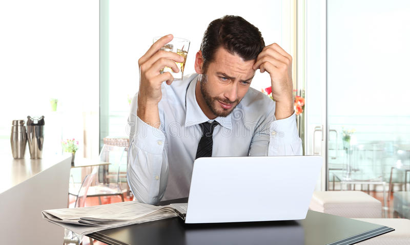Worried and tired businessman in crisis working on computer royalty free stock photos
