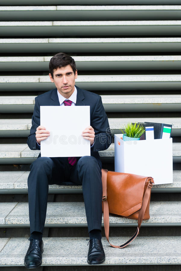 Worried unemployed businessman stock image