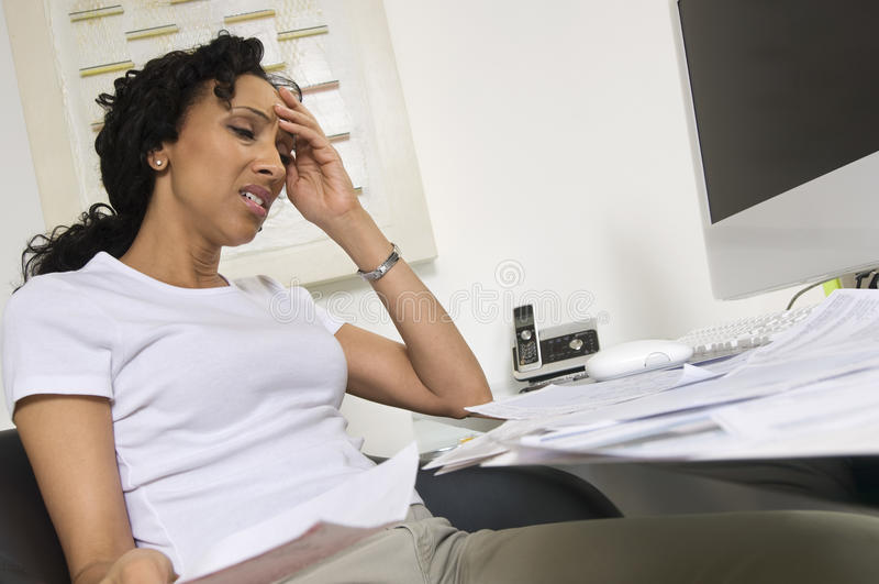 Worried Woman Doing Finances stock photo