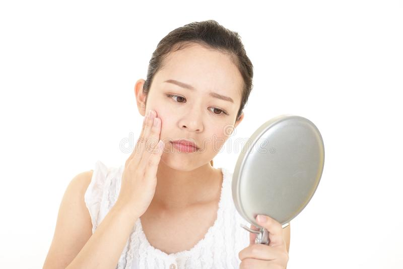 Worried woman having skin problems stock photos