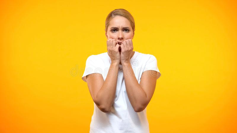 Worried woman looking camera, panic attack, fear expression, stress reaction stock image