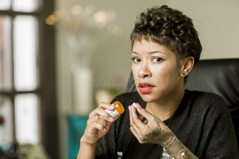 Worried Woman with an Opioid Prescription Pill royalty free stock images