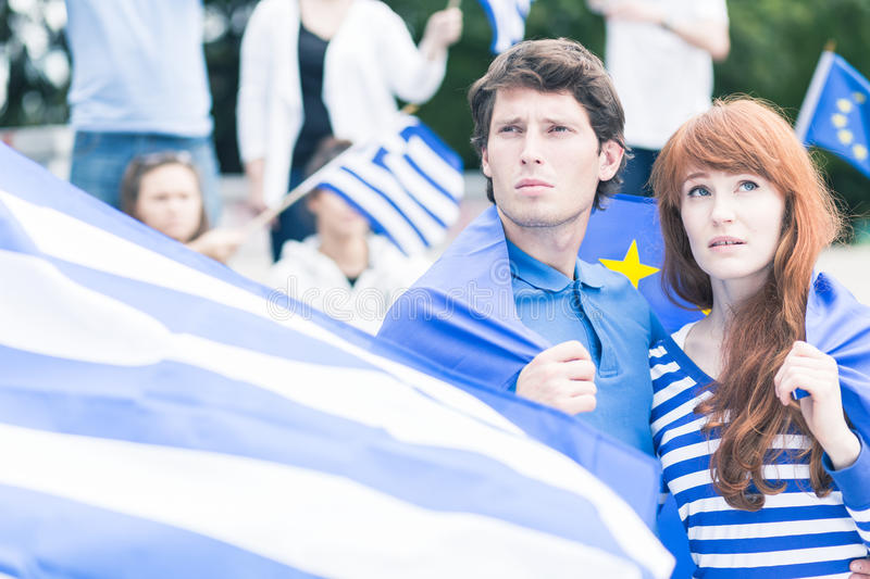 Worried young Greeks. Participating in mass meeting stock images
