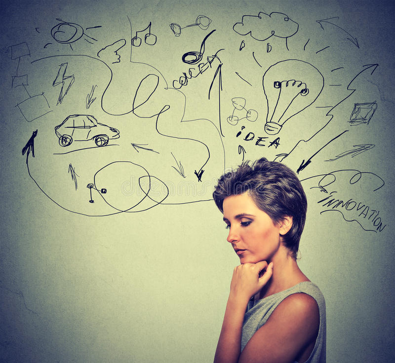 Worried young woman thinking dreaming has many ideas looking down stock images