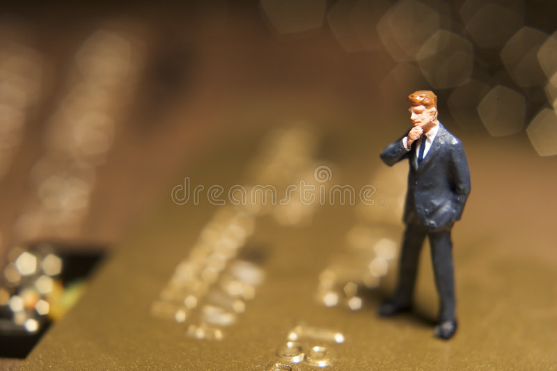 Worried about your credit card?. Business figures and credit card royalty free stock images