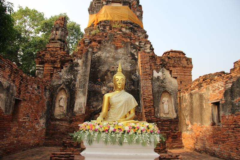 Worship. Buddhist Temple  And Old Stupa With Bricks Walls. Ruins. Choeng Tha temple with old pagoda and bricks walls Buddhist historical park. summer in royalty free stock photo
