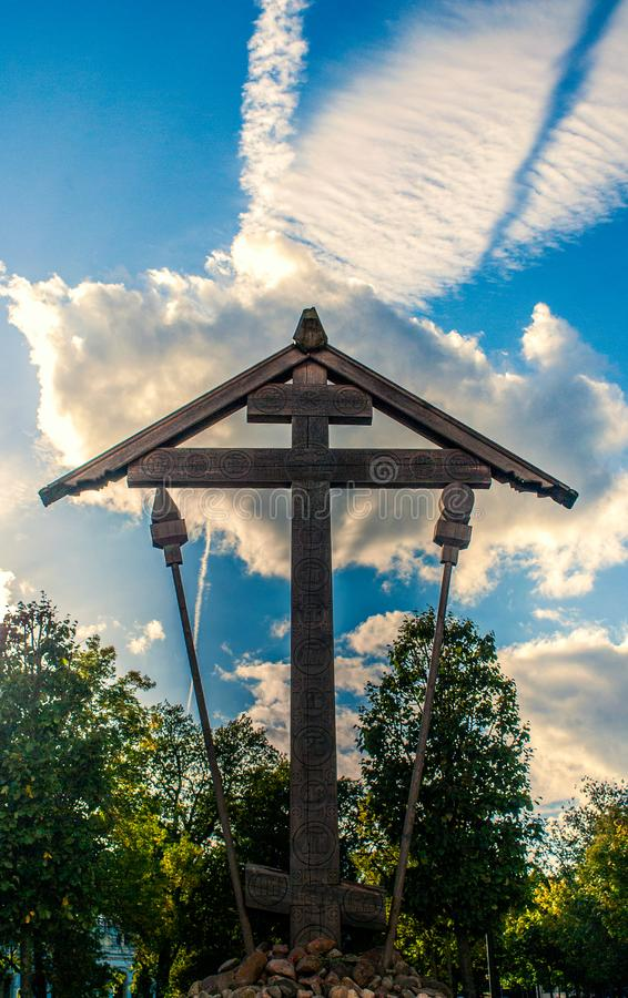 Worship the cross. At St. Catherine`s Cathedral in Pushkine.V memory of the destroyed temple and once buried in it the life of Saint Catherine`s Cathedral royalty free stock photos