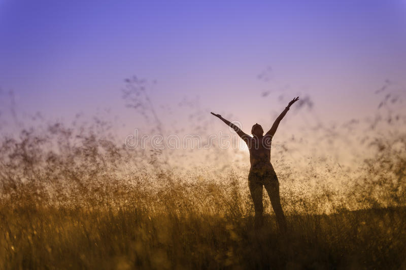 Download Silhouette Of A Woman Lifting Her Hands In Worship Stock Image - Image: 32488539