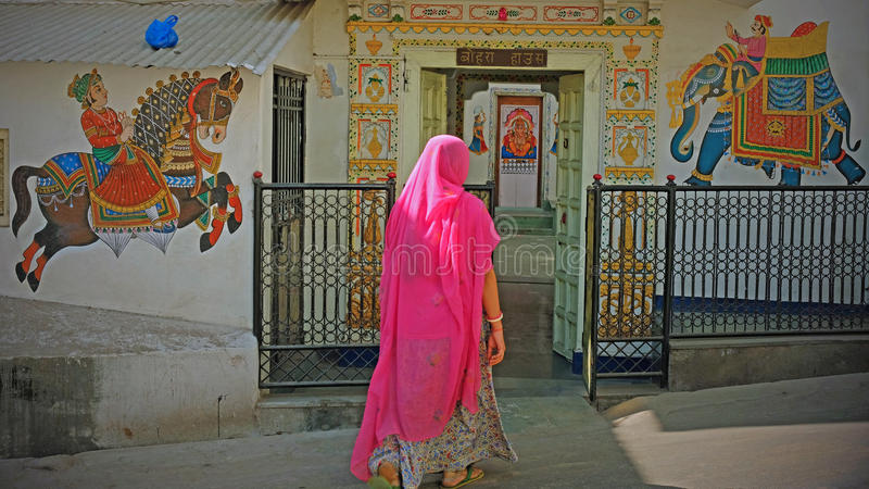 Worshipper entering a Hindu temple in Udaipur, India stock images