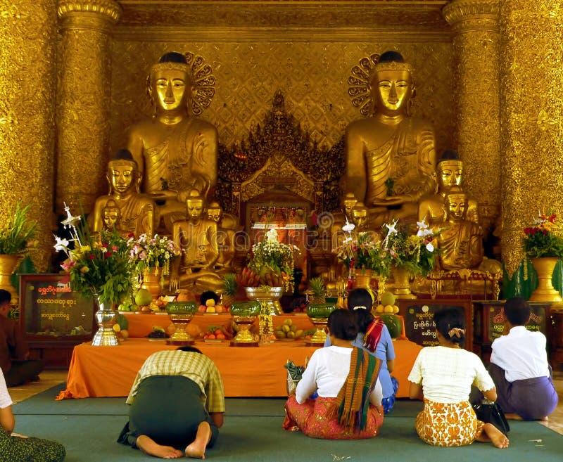Worshippers in Temple. Shwedagon Pagoda. Yangon Myanmar (Rangoon Burma royalty free stock image