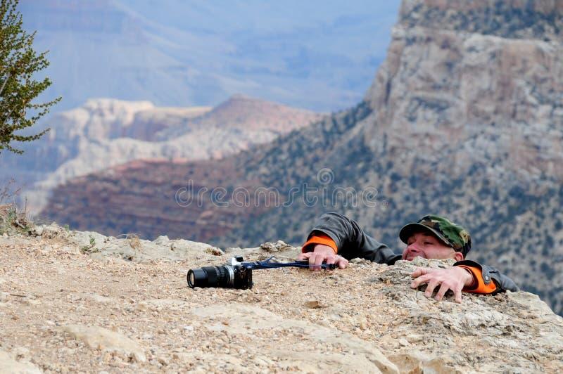Worstelende fotograaf stock afbeelding