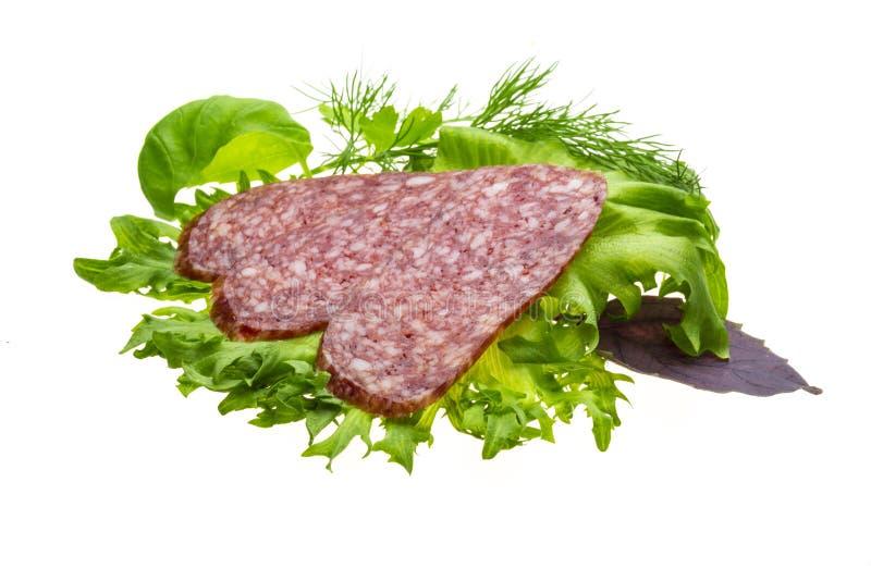 Worsten met salade en basilicum royalty-vrije stock afbeelding