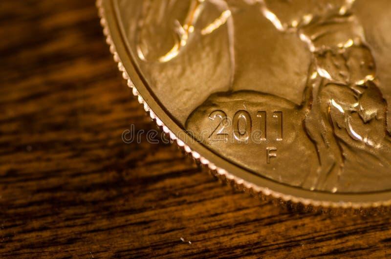 2011 (Wort) auf Goldbüffel-Münze Vereinigter Staaten lizenzfreies stockfoto