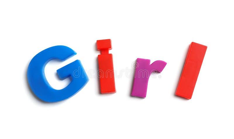 Wort MÄDCHEN von magnetischen Buchstaben auf weißem Hintergrund lizenzfreies stockfoto