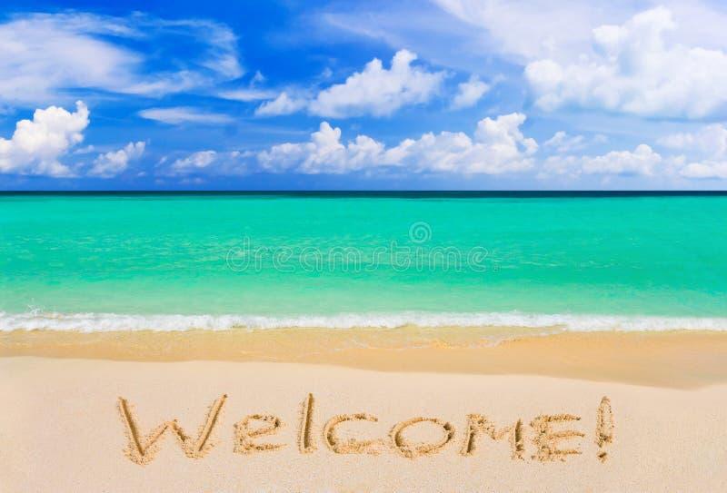Wort-Willkommen auf Strand lizenzfreies stockfoto