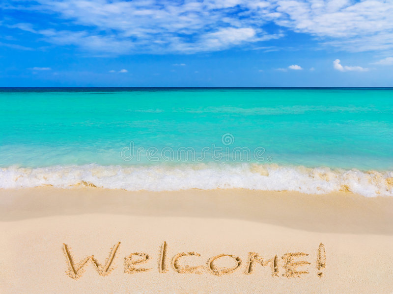 Wort-Willkommen auf Strand stockbild