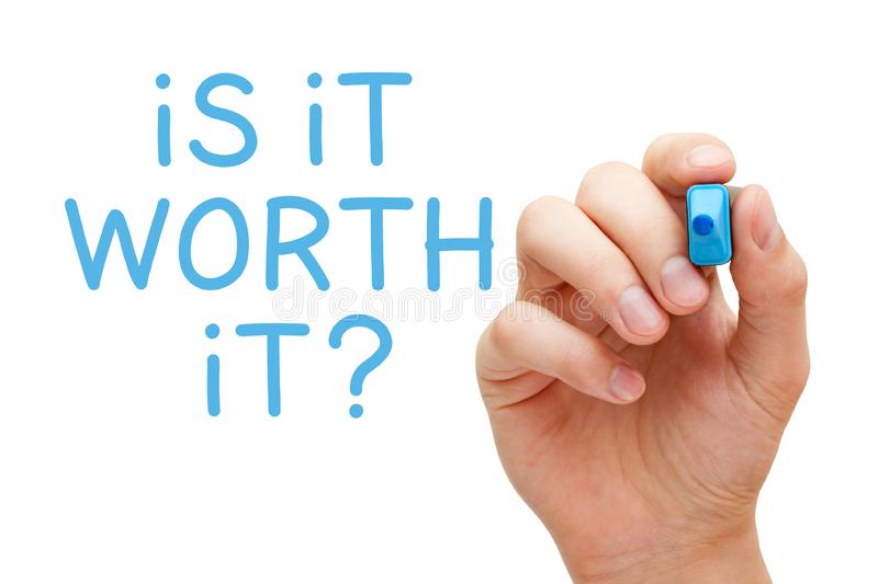 Is It Worth It Question Concept. Hand writing the question Is It Worth It with blue marker on transparent glass board isolated on white royalty free stock photography