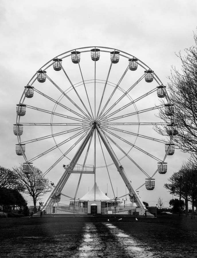 The Worthing Eye. Worthing, United Kingdom - March 29 2018: The Worthing Eye ferris wheel on the sea front stock photography