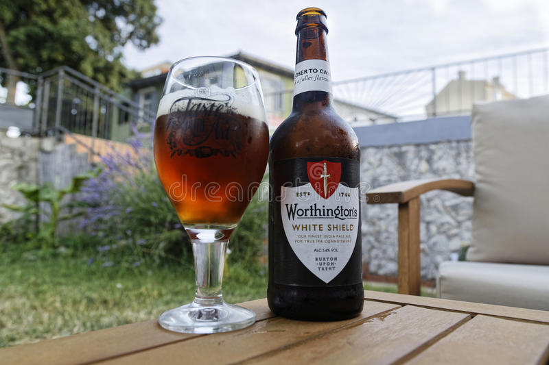 Worthington`s white shield. PULA, CROATIA - JUNE 10, 2017: Worthington`s White Shield is an English India Pale Ale. White Shield was first brewed by the stock photos