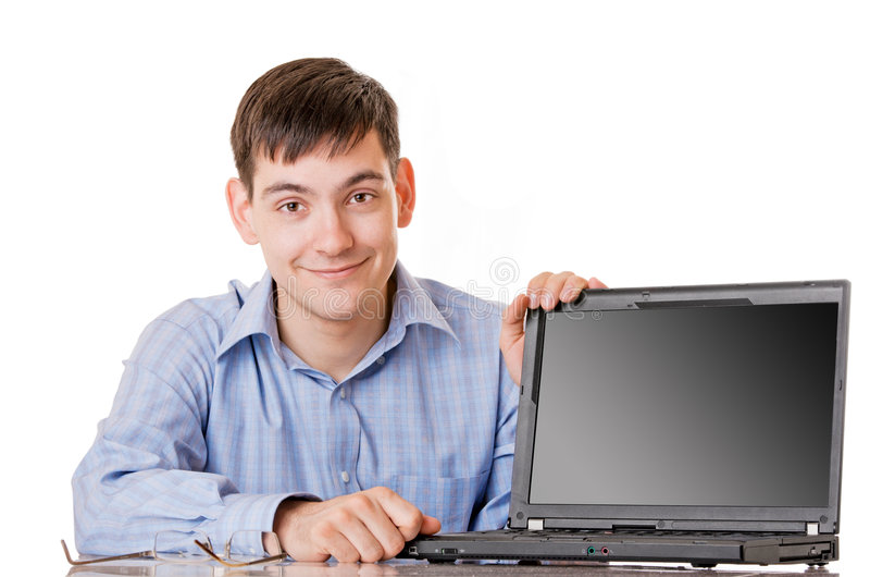 Woth del giovane un computer portatile immagine stock