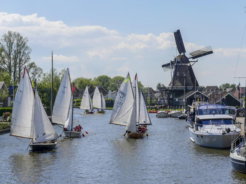 Brio sailing marathon passes through Woudsend. Woudsend, the Netherlands - May 20, 2017: During the annual Brio Sail Marathon the sailboats also sail and paddle stock images