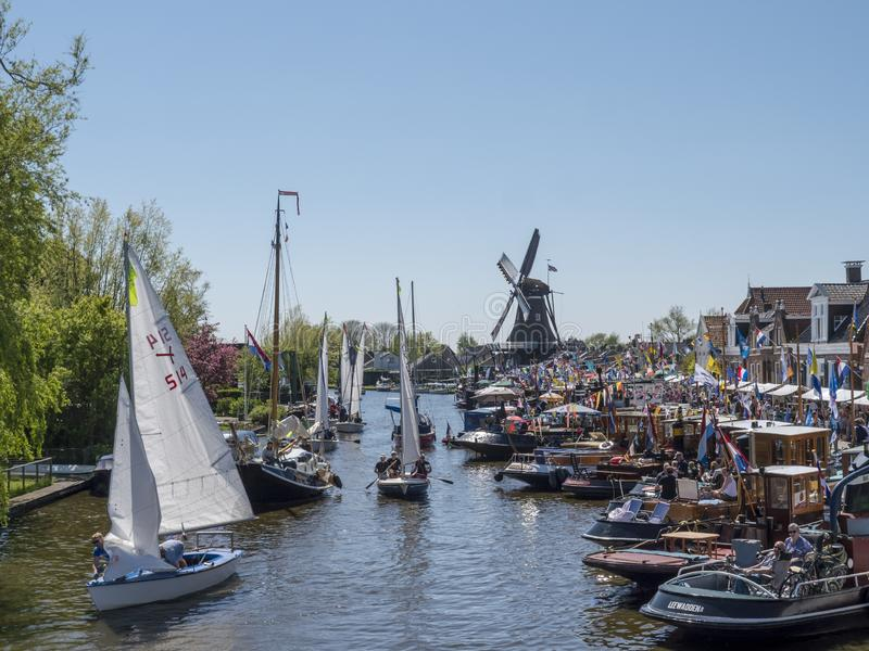 Brio sailing marathon passes Woudsend during the Frisian Tugboat Days. Woudsend, The Netherlands - May 5 2018: During the Frisian Tugboat Days, participants of stock image