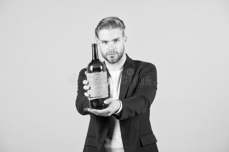 Would you like to try this. Sommelier offer bottle of wine. Professional wine degustation concept. Man formal suit with. Wine bottle in hand. Sommelier handsome stock photo