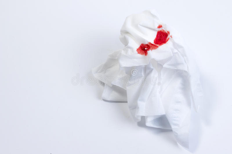 Wound blood, blood on tissue paper on white background. Nosebleed or epistaxis treatment blood in tissue paper. Health medical royalty free stock image