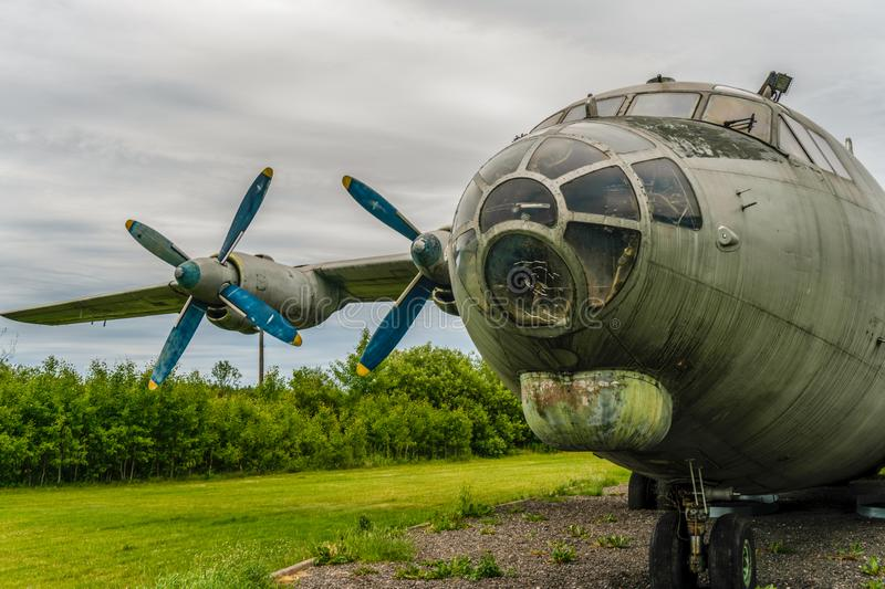 Wounded bird! Abandoned Soviet military transport aircraft royalty free stock photography