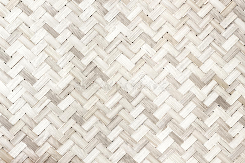 Woven bamboo pattern/white wood texture background royalty free stock images