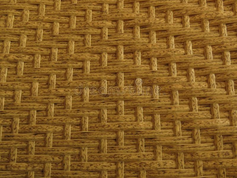 Woven Bamboo Rattan Fence Background Straw Weave Texture. Rattan furniture texture. Rustic lifestyle furniture royalty free stock images