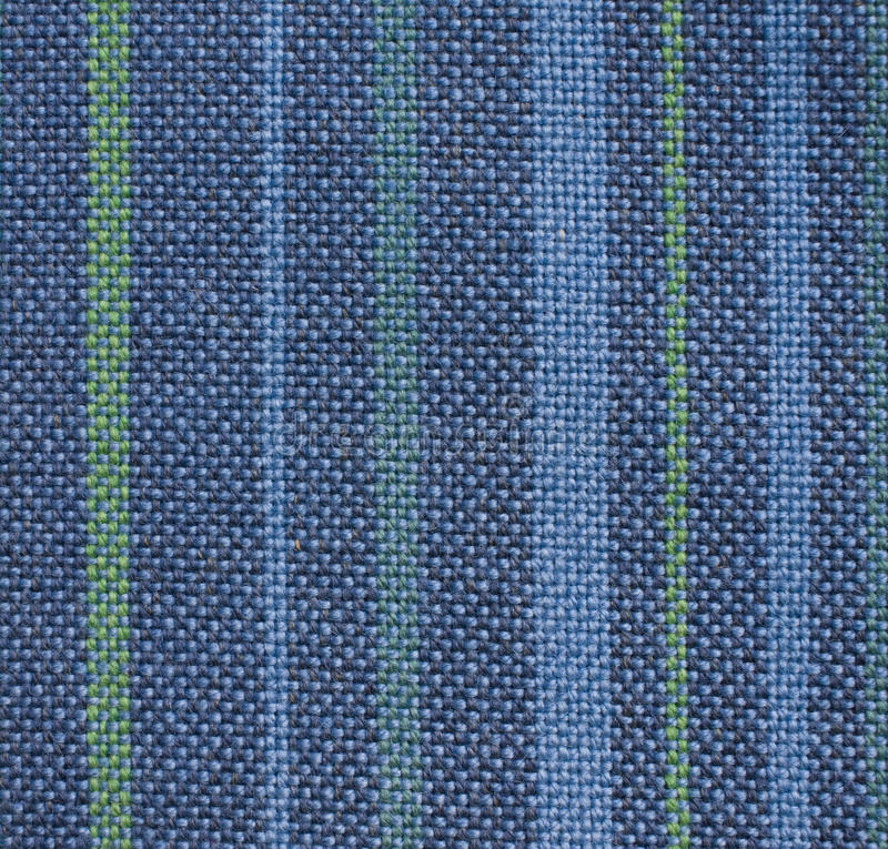 Woven fabric. Woven wool fabric in blue and green royalty free stock photo