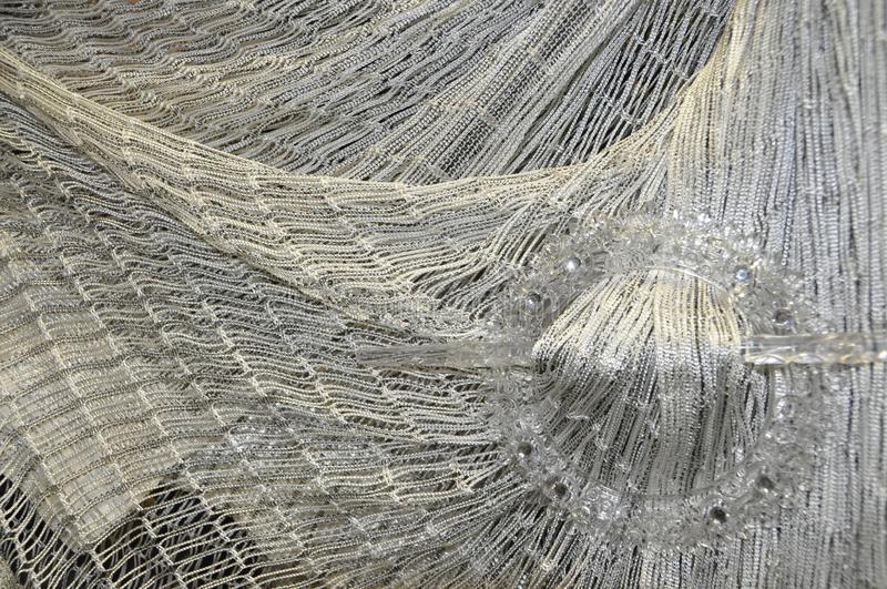 Woven fabric. Material achrom,woven fabric drapery network stock photo
