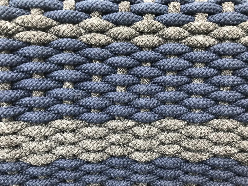 Woven grey and dark blue small tight cotton rolls as a pattern of wicker stock photos