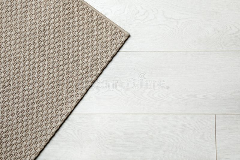 Woven mat on wooden background, top view. With space for text royalty free stock image