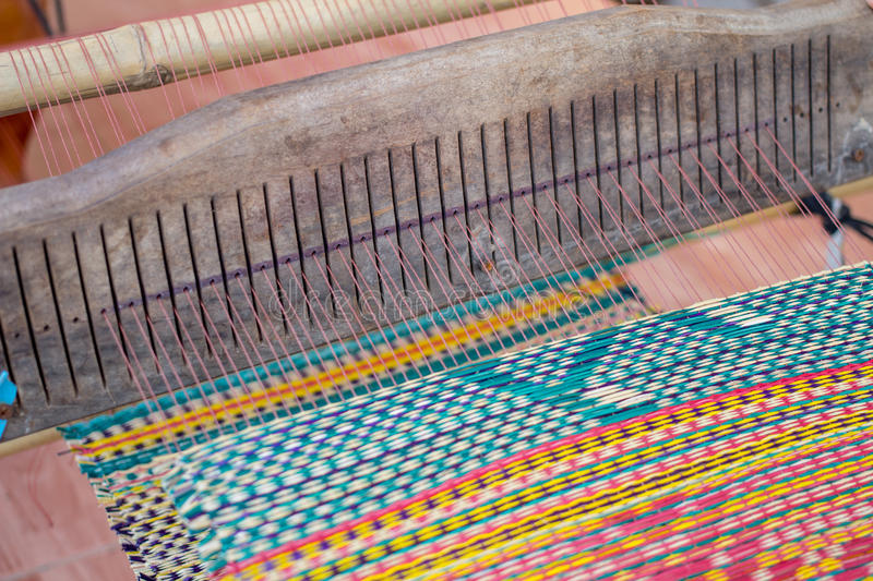 Woven mats handmade from dry reed imbue make. In thailand royalty free stock photography