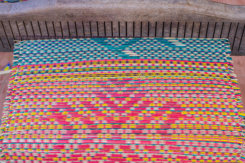 Woven mats handmade from dry reed imbue make. In thailand royalty free stock photos