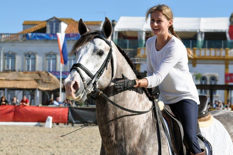 WOW女孩骑乘马 免版税库存照片