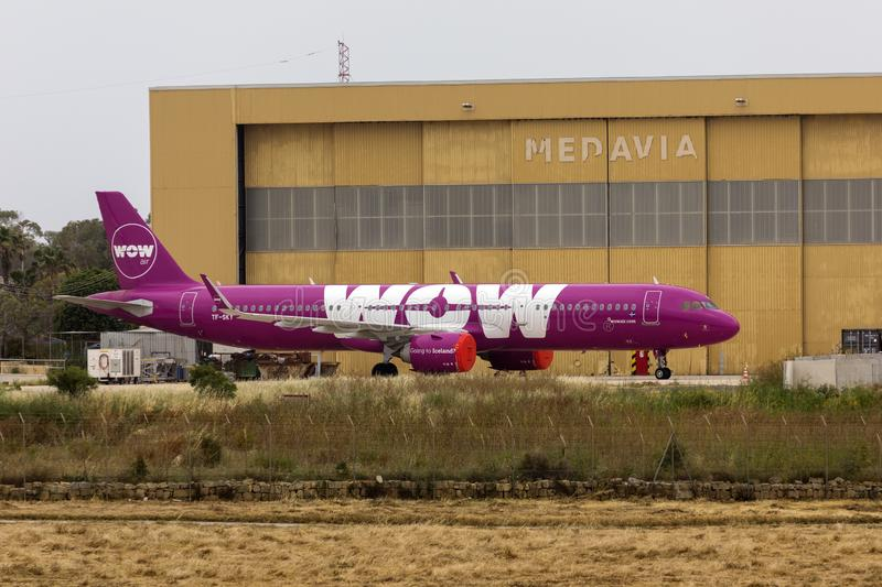 WOW Air of Iceland after it ceased operations. Luqa, Malta - May 18, 2019: WOW Air Airbus A321-253N REG: TF-SKY stored in from Medavia hangar after WOW Air royalty free stock photos