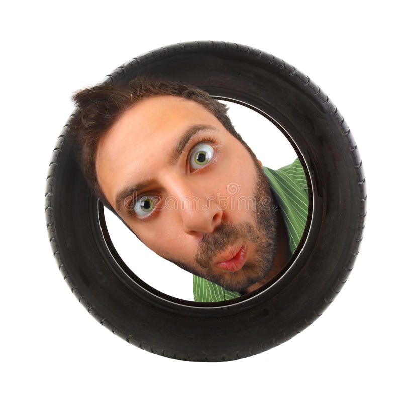 Wow expression in the car tire stock photography
